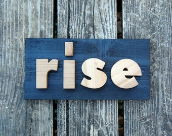 RISE sign made from cedar treehouse scraps
