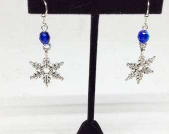Snowflake earrings with blue crystal accent
