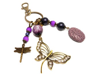 A scent! bronze bag charm, dragonfly and Pearl tone mauve and purple