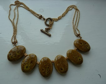 New necklace of pebble like stones
