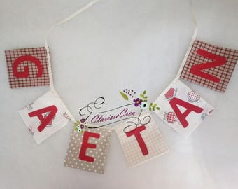 """Garland """"pockets"""" square with name in red and beige"""