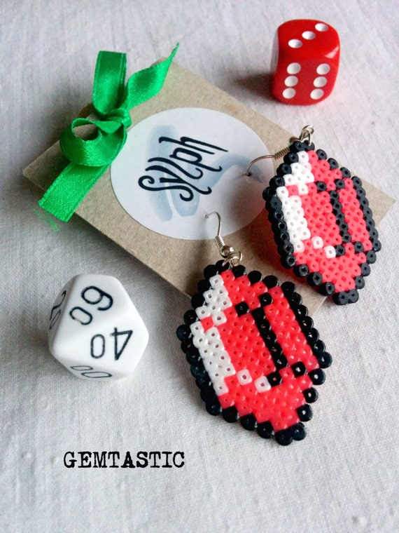 Shiny white and bright pink pixelated Zelda game inspired Gemtastic pixel earrings for gamer girls made of Hama Mini Perler Beads