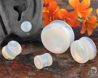 "Concave Opalite plugs 2g (6mm), 0g (8mm), 00g (9.5mm), 7/16"" (11mm), 12mm, 9/16"" (14mm), 5/8"" (16mm), 3/4"" (19mm), 7/8"" (22mm), 1"" (25mm)"