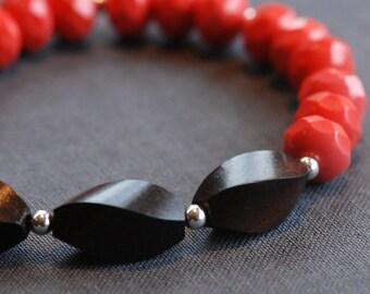 coral red glass and ebony bracelet