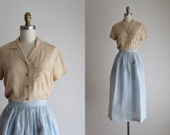 ecru silk blouse