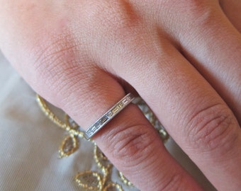 Platinum Baguetts &  princess cut diamonds channel set wedding band