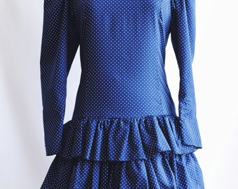 Blue polka dot ruffled dress.