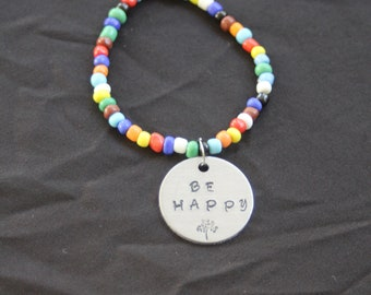 "Stretchy beaded bracelet "" be happy"""