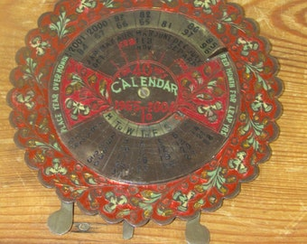 Vintage painted brass perpetual calendar 1965 to 2004