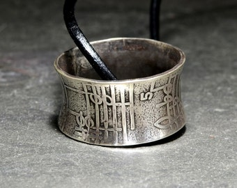 Sterling Silver Anticlastic Ring Necklace with Musical Inspiration and Rustic Patina