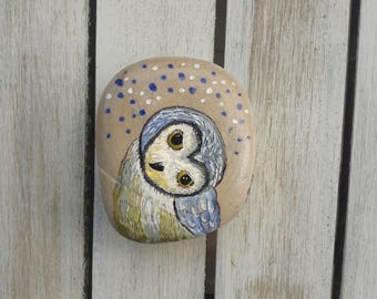 Cute owl painted on a pebble