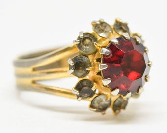 Lovely gold tone and red stone ring