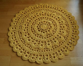 Yellow crocheted doily rug