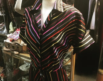 "An exceptionally well-striped 1940s gown ""ribbon dress"""