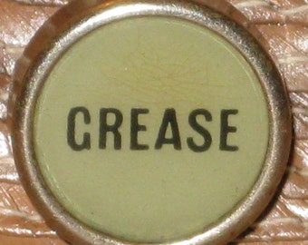 "Hat Pin, 1920 Automotive Store Cash Register Button, ""GREASE"""