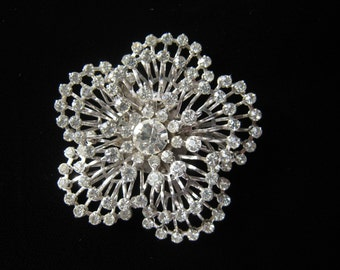 Beautiful rhinestone brooch is a lovely bright accessory