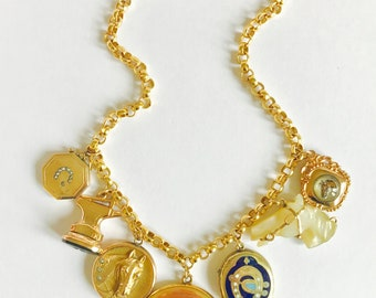 Equestrian necklace with antique lockets, watch fobs and charms.