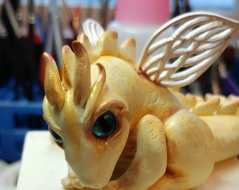 Golden Dragon w/ bronze highlights and Silver Wings,