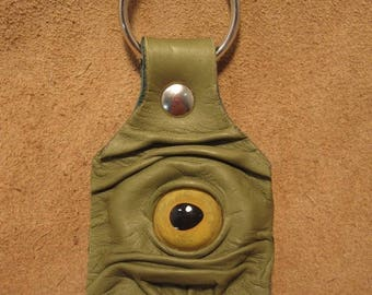 Grichels leather keychain - spring green with yellow fish eye