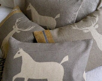 hand printed white  chalk horse cushion