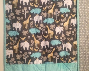 Modern, gender neutral quilt. Baby boy quilt. Baby girl quilt. Animal print quilt. Hand made quilt. Turquoise. Gray. Modern motif.