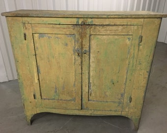 Beautiful primitive cupboard mustard over green paint 16d48.5h52.5w Chamfered door panels  shipping is not free