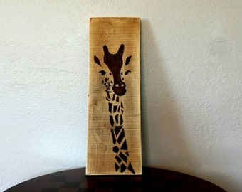 Beautiful African style giraffe, painted with walnut stain on recycled wood.