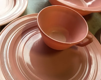 Four Cups, Six Plates and One Big Bowl of Delicate Pink with Concentric Circles by Hazel Atlas between 1934 - 1942