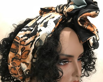 Long reversible, animal print scarf with flower