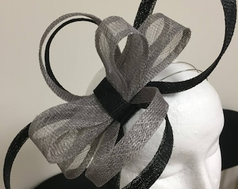Unique grey and black loop fascinator with bow centre!