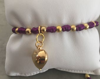 Yellow gold plated bead purple string adjustable size bracelet