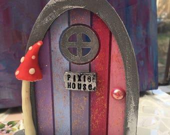 Fairy door pixie with glow in the dark toadstool