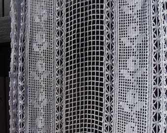 French antique hand made, white cotton filet crochet curtain panel, with vertical columns and finished with fringed base.
