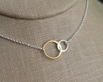 Interlocking rings necklace in sterling silver and gold, two linked circles, interlocking circles, silver and gold, mother's day