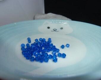 Set of 65 beads SWAROVSKI bicones - CAPRI BLUE 4 mm