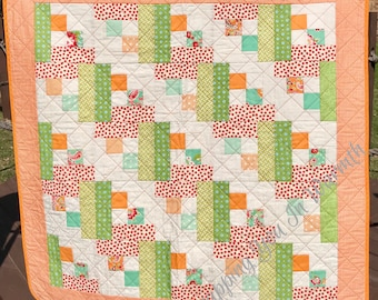 "Orange, Aqua, Red and A Touch Of Bright Green Blend Beautifully In This 39"" X 39"" Log Cabin Quilt"