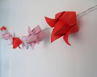 Garland light origami lotus flowers