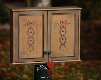 """Wall cabinet doors and aged patina """"knotted Ribbon and hearts"""