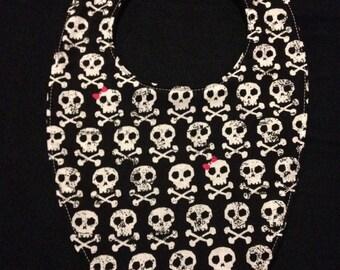 Skulls and crossbones baby bib
