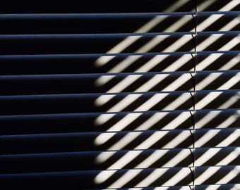 Black and White Photo of Crosshatch Intersection of Blinds and Light