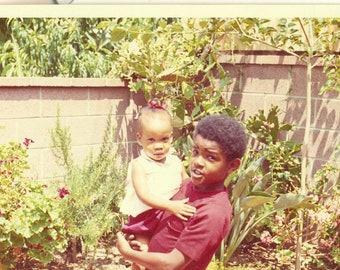 1970s Big Brother Holding Little Girl African American Black Brother Sister Kids 70s Vintage Photograph Color Photo