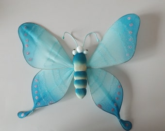 """Christmas collectible ornament.Blue large butterfly, 9.5""""W, 8""""H. Christmas tree ornament."""