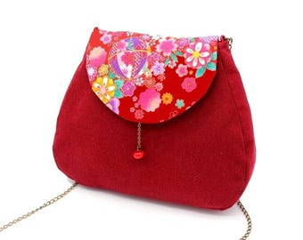 Red messenger bag enhanced with red Japanese fabric patterned with cherry blossoms and Japanese motifs