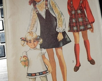 """1969 Simplicity Pattern 8529 Uncut Girls sizes 10  Breast 28 1/2"""" Girls Jumper and dress...factory folded"""