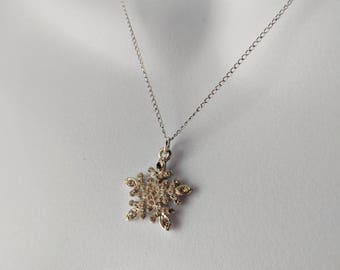 Sparkling Snowflake Necklace on a silver curb chain