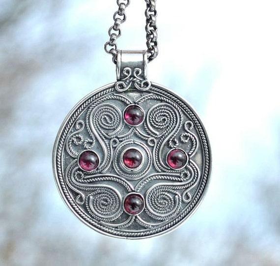 Celtic silver pendant battersea england garnet museum copy aloadofball Image collections