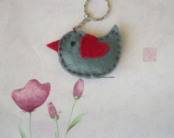 grey and red felt bird key chains