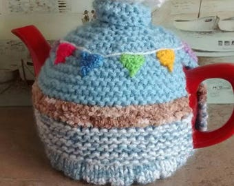 Hand-knitted seagull and bunting tea cosy.