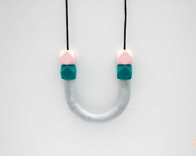 Pink and Green U tube beaded silicone necklace.