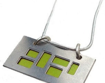 silver pendant with Lime and Black cutouts